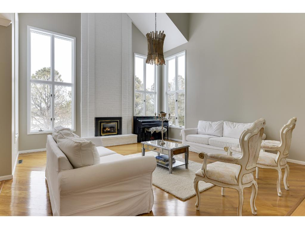 Dramatic Open Floor Plan, A Bold Brick Fireplace, Smooth White Ceilings,  Crown Molding