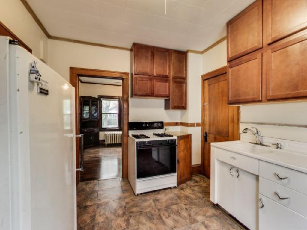 Charming kitchen offers great functionality and storage featuring original cabinets and retro sink cabinet that's in great shape.
