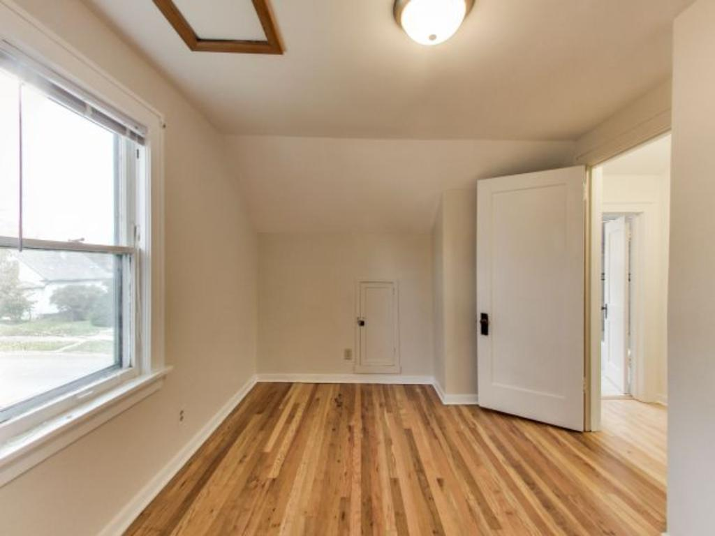 The West bedroom features newly refinished red oak original hardwood floors.