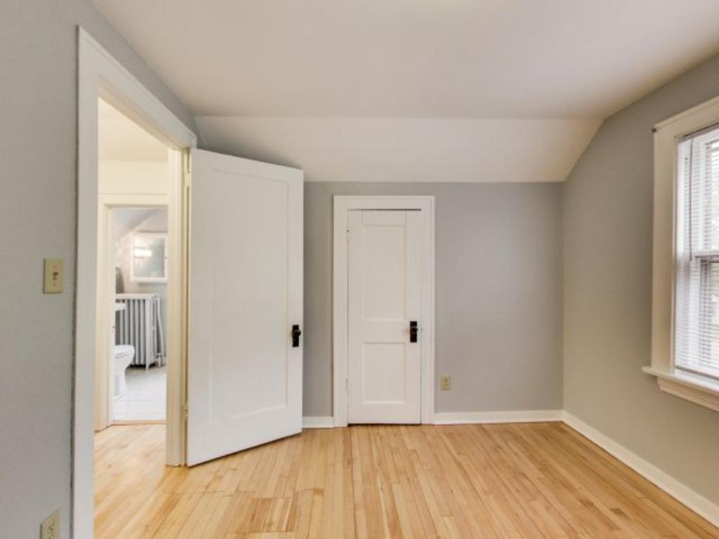 """The East bedroom features great """"walk in"""" closet space and plenty of natural light. Great ceiling height and spacious square footage as well."""