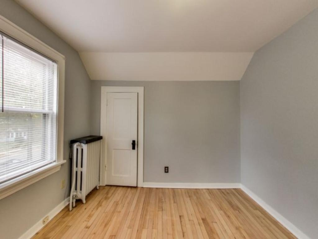 The East bedroom features newly refinished maple flooring and a second walk-in closet.