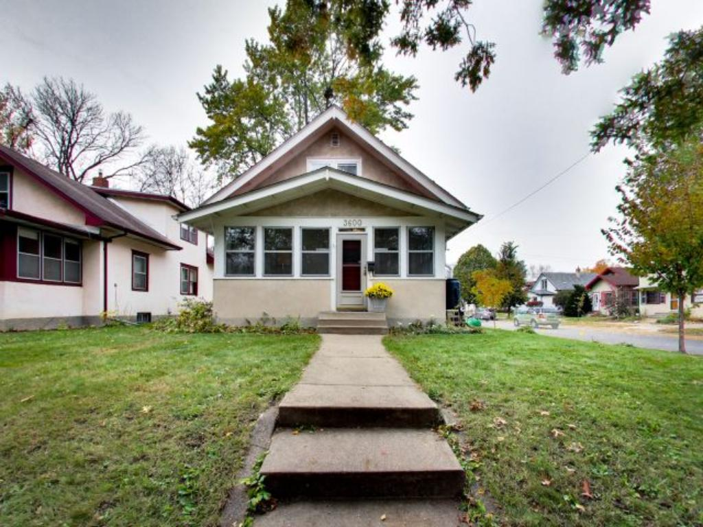 This cute story and a half home offers plenty of charm throughout. Featuring stucco on the outside. Fantastic front porch where you could sip your morning coffee or evening wine.