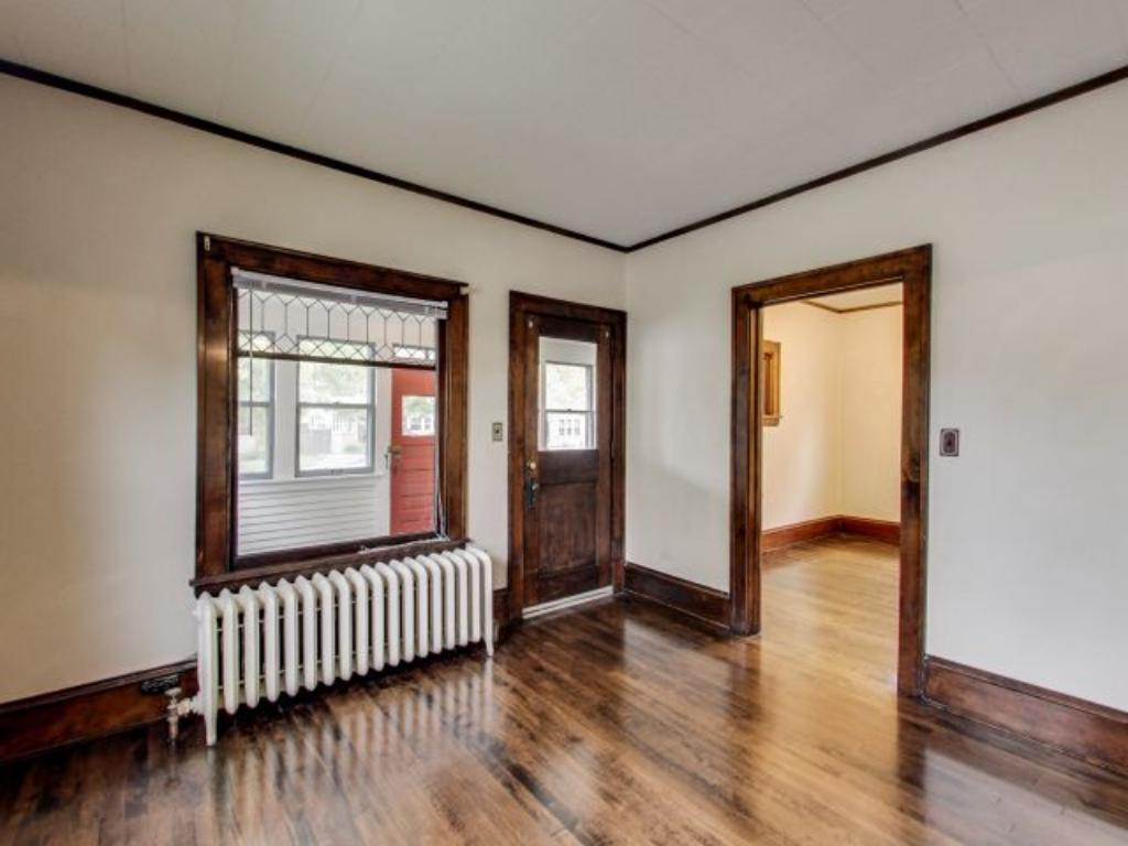 Original woodwork, hardwood floors, and leaded glass window in the living room offer all the old home charm as you enter. The main floor features newly refinished Birdseye Maple flooring.