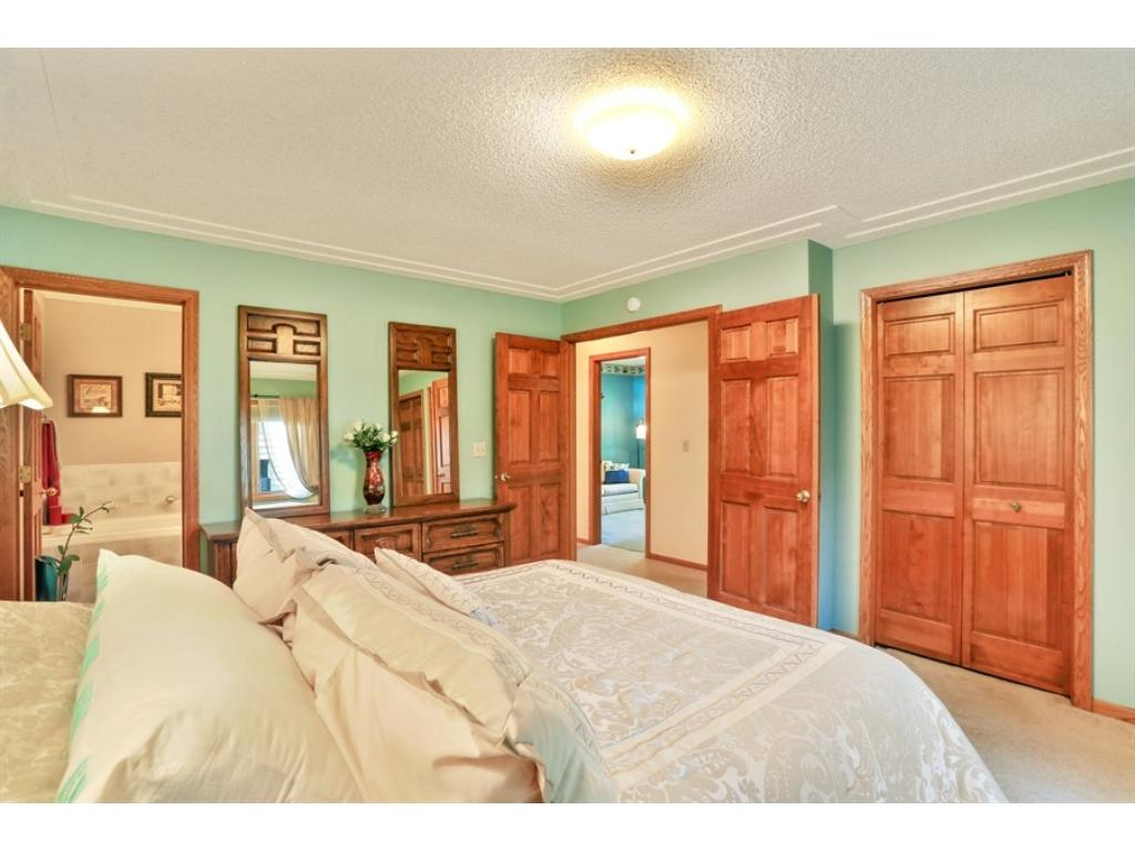 Master bedroom features a walkthrough bath from the master bedroom and beautiful French doors.