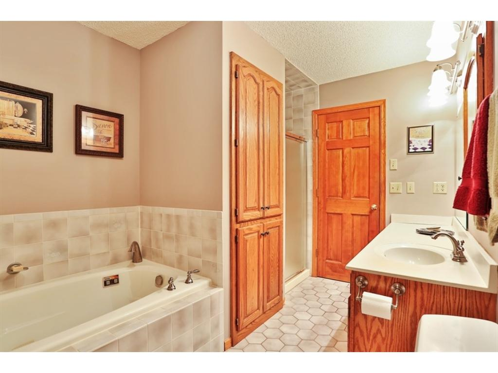 Upper level bath with separate tub and shower as well as a large vanity with a makeup counter.