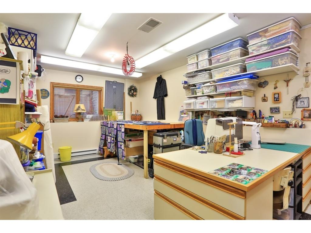 Hobby/sewing room in lower level is the perfect space for anything: Playroom, workout space, craft room, you name it!
