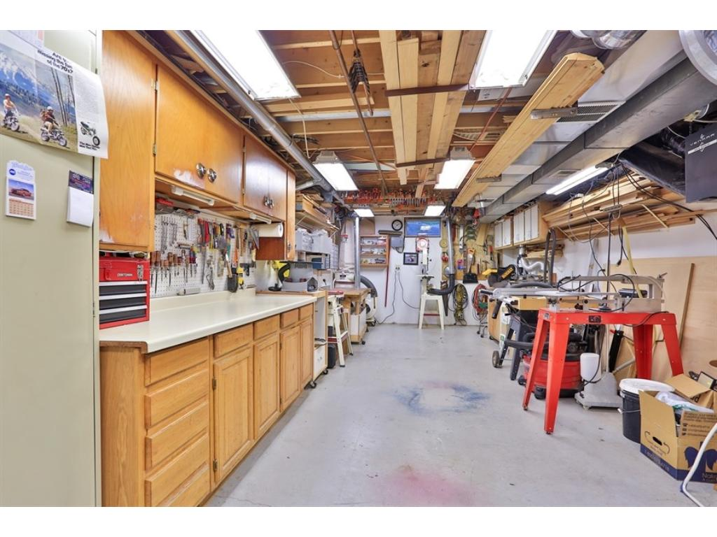 Basement features the craftsman's paradise with a huge indoor workshop.