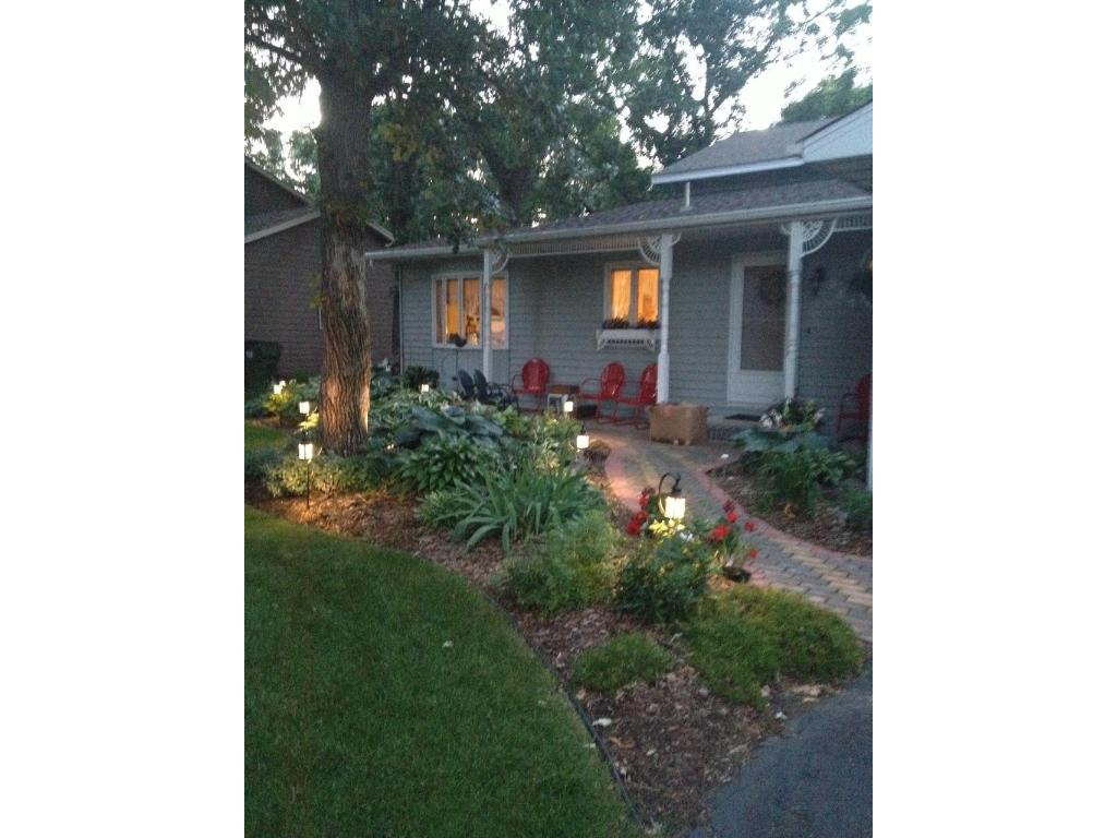 Beautifully landscaped yard with lighting gives this home a welcoming look any time of day.