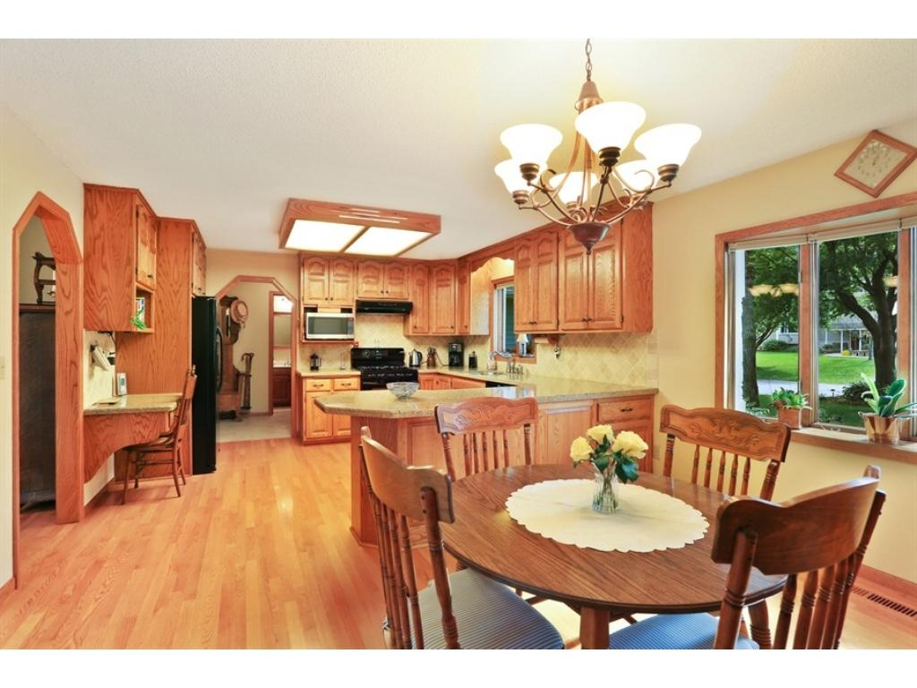 Large kitchen with built in desk and lots of room for entertaining guests