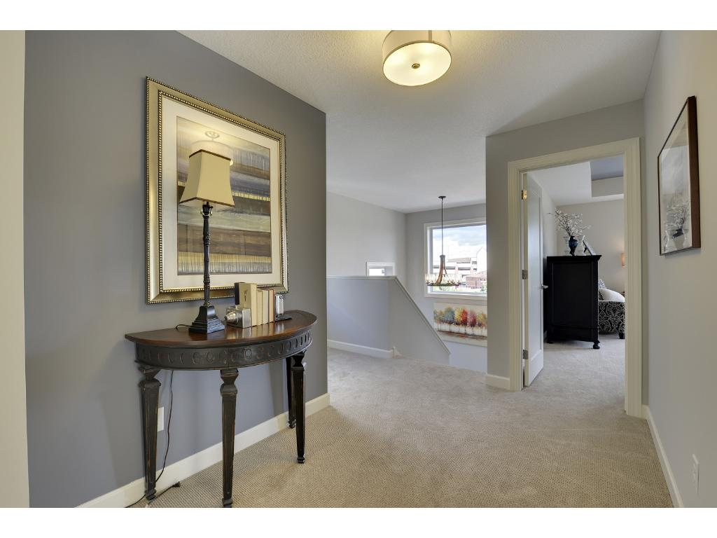 Enjoy the Juliet balcony located in your master bedroom. Visit us on-site to tour the model. Pleasant Ridge. Summit Hill., St. Paul.