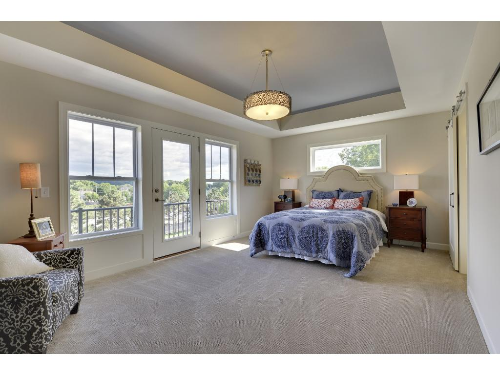 Great sunlight and views from your large master bedroom windows. Visit us on-site to tour the model. Pleasant Ridge. Summit Hill., St. Paul.