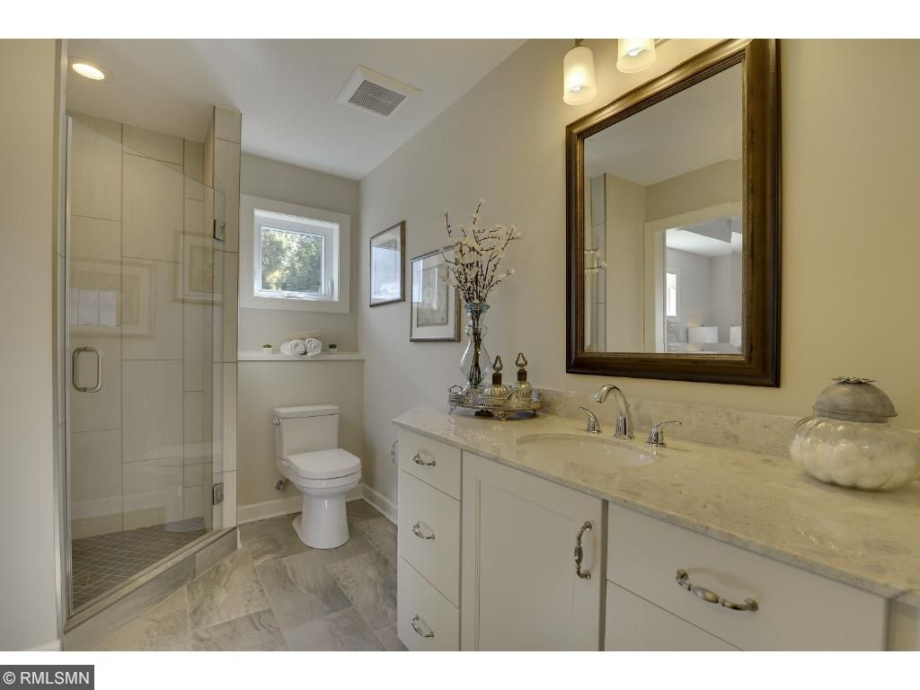 This master bathroom features dual sinks and counters and leads to the walk-in closet built for two. Visit on-site to tour the model. Pleasant Ridge. Summit Hill., St. Paul.