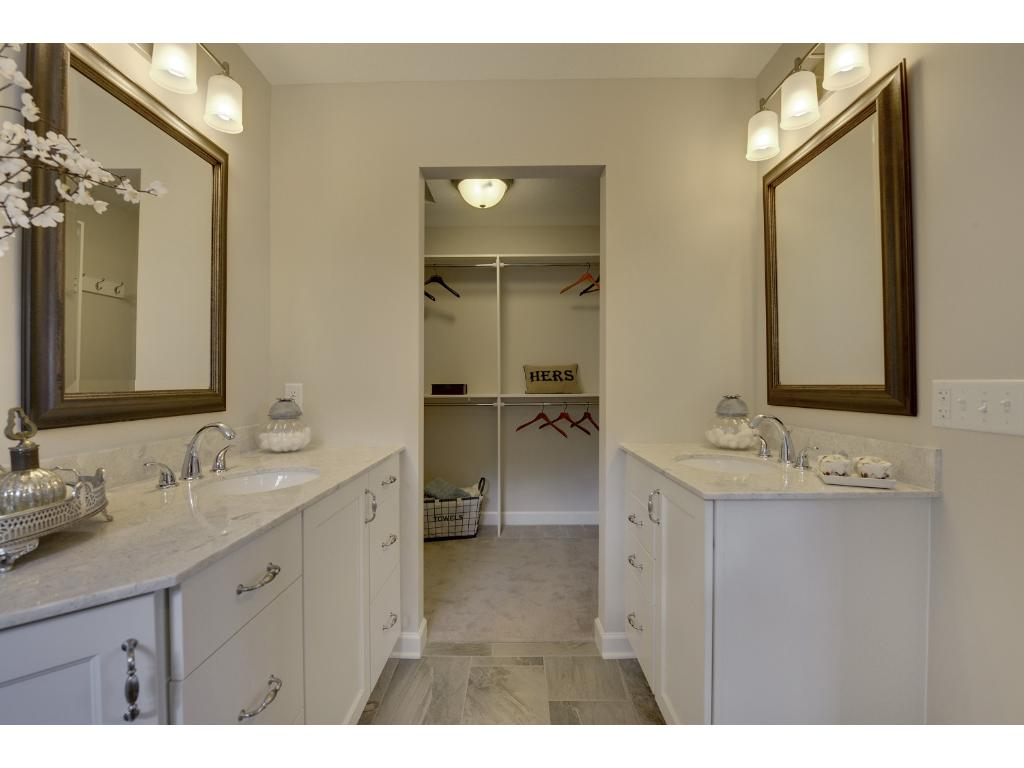 This large walk-in closet is conveniently located of the bathroom. Visit on-site to tour the model. Pleasant Ridge. Summit Hill., St. Paul.