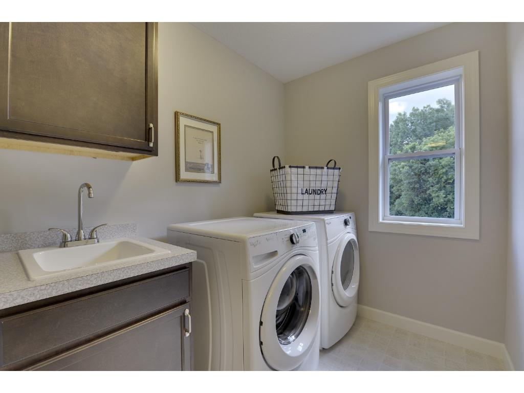 You're sure to love the upper level laundry room. Visit on-site to tour the model. Pleasant Ridge. Summit Hill., St. Paul.