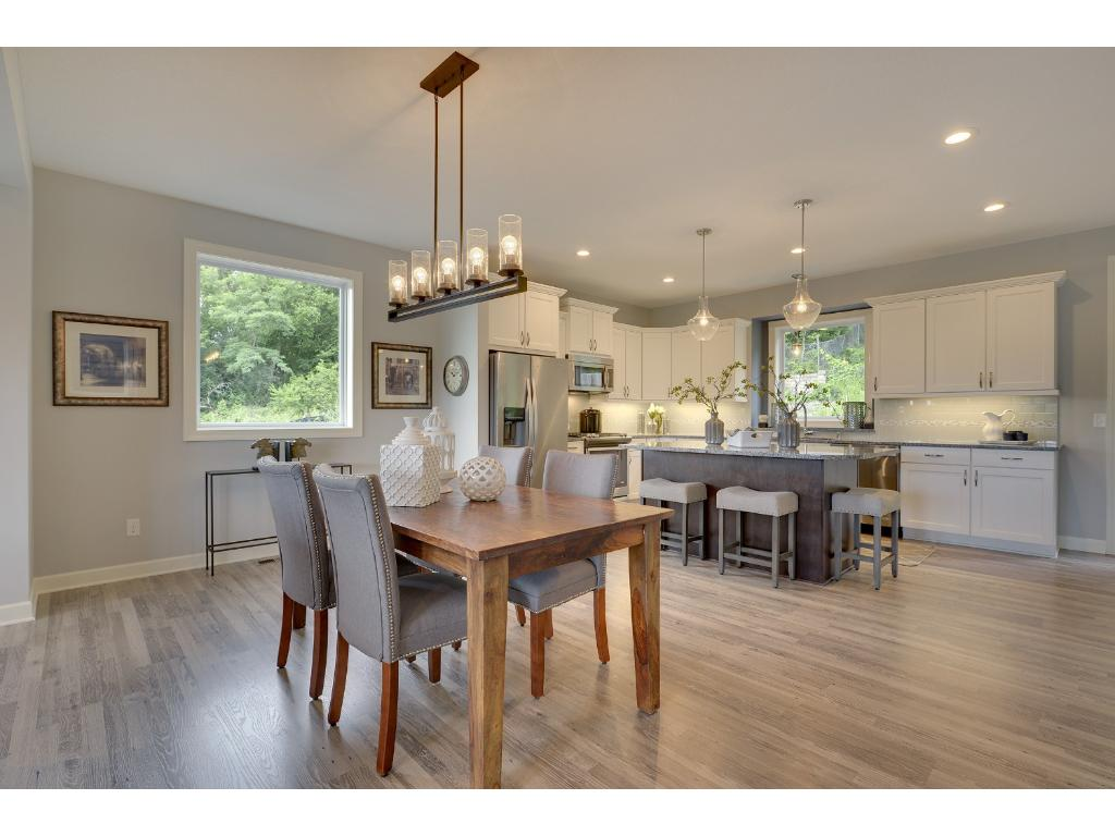 The dining room space is perfect for formal and informal meals alike. Visit on-site to tour the model. Pleasant Ridge. Summit Hill., St. Paul.