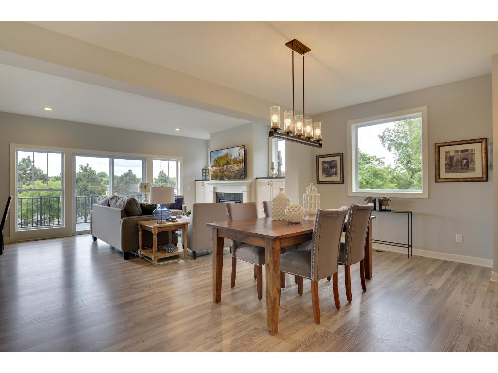 Large center island, granite counters, and stainless appliances. Visit us on-site to tour the model. Pleasant Ridge. Summit Hill., St. Paul.