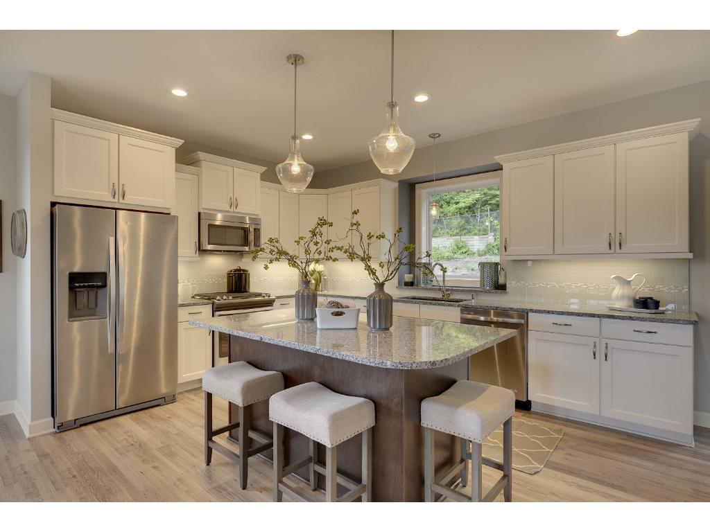 Ample space for many cooks in this kitchen. Visit on-site to tour the model. Pleasant Ridge. Summit Hill., St. Paul.