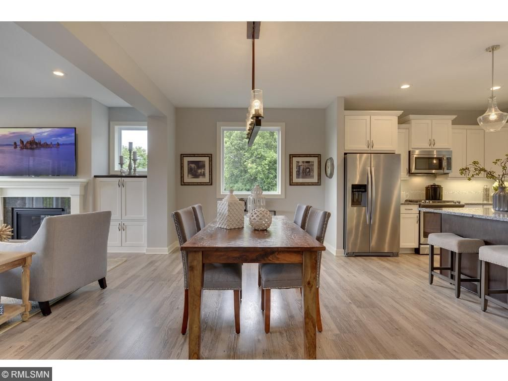 Large center island, granite counters, and stainless appliances. Visit on-site to tour the model. Pleasant Ridge. Summit Hill., St. Paul.