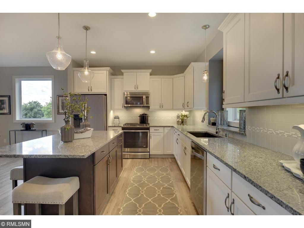 You'll love the open layout of this kitchen/dining/living great room space. Visit us on-site to tour the model. Pleasant Ridge. Summit Hill., St. Paul.