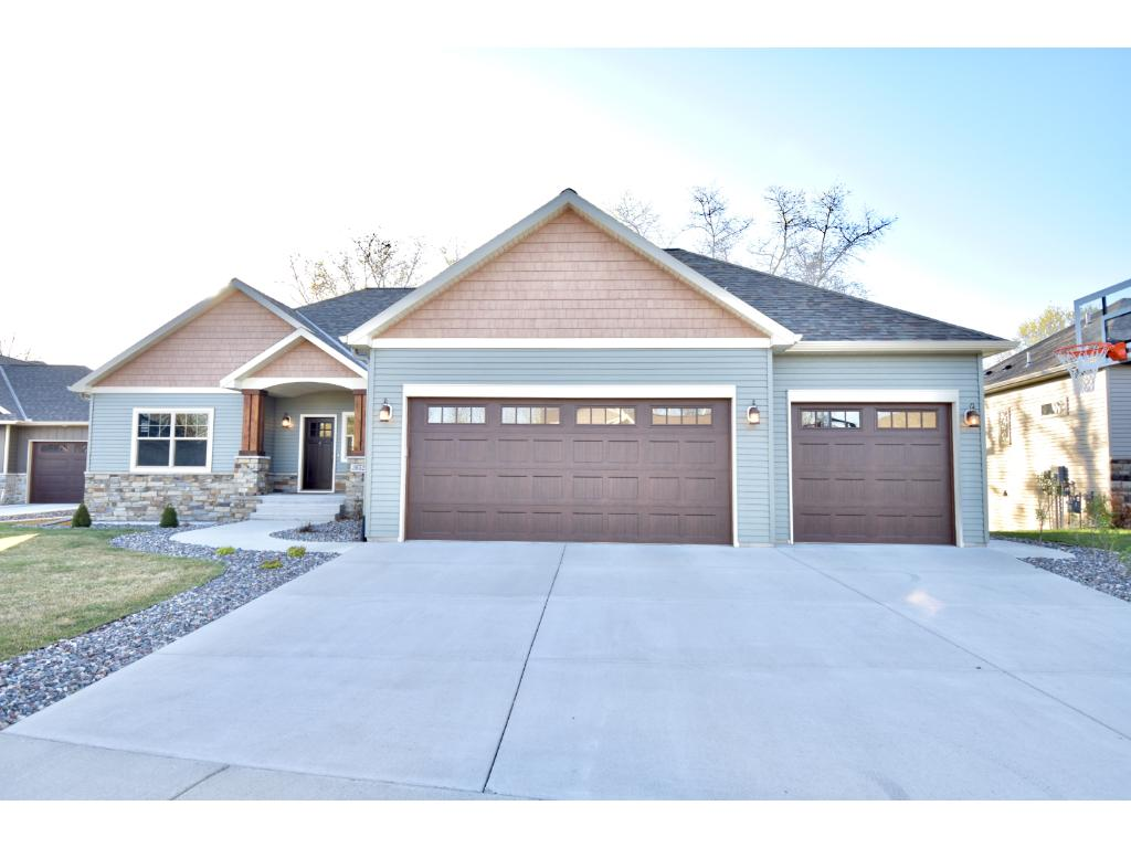 walkout rambler with large deck and patio that overlooks nature preserve home is situated on