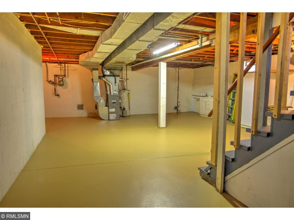 Large basement with tall ceilings, perfect area for equity-building expansion.