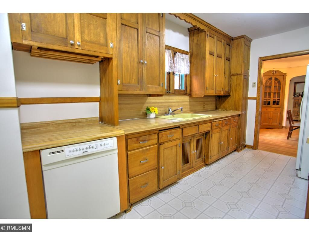 Rare to find original cabinets! Beautiful vintage charm in this large kitchen!