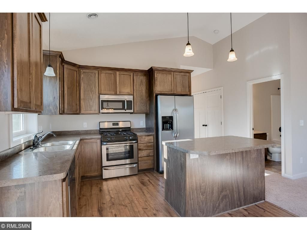 Eat in kitchen with counter seating and stainless steel appliances.Photo: 370 Ladd Ln.