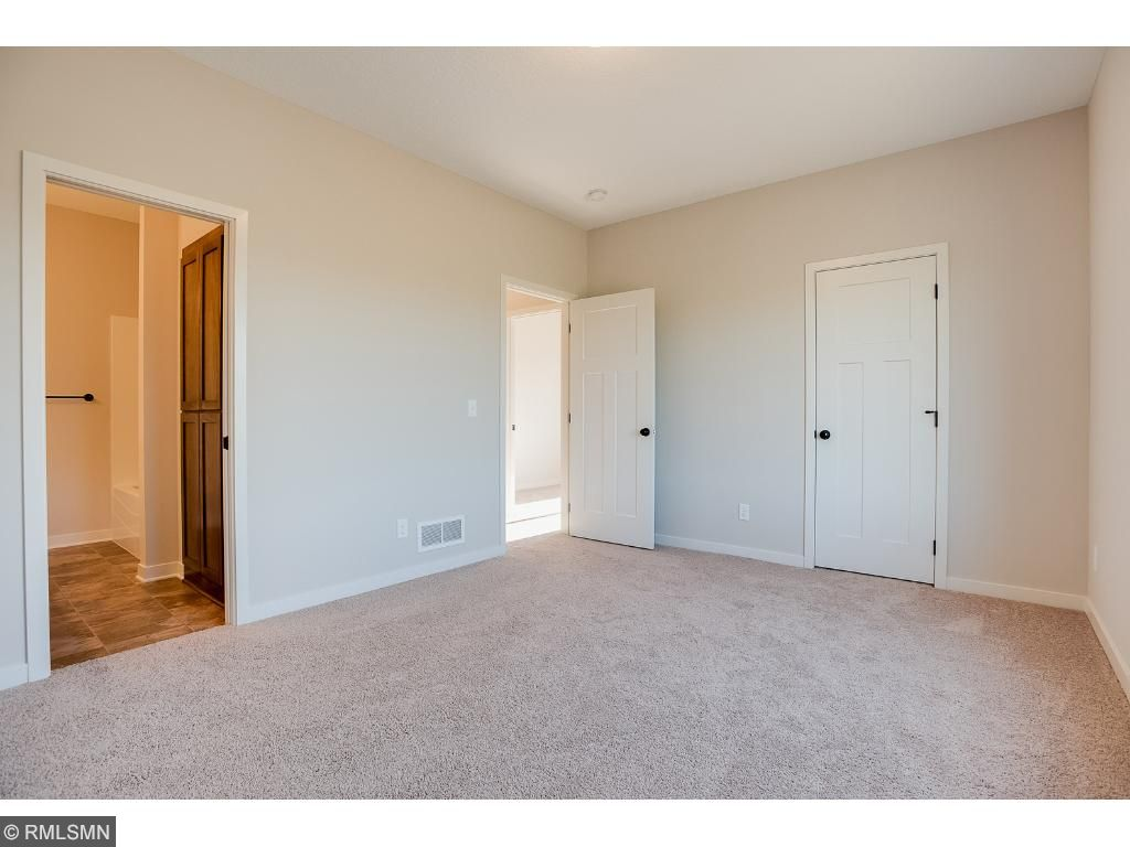 Master bedroom with walk in closet and master bathroomPhoto: 370 Ladd Ln.