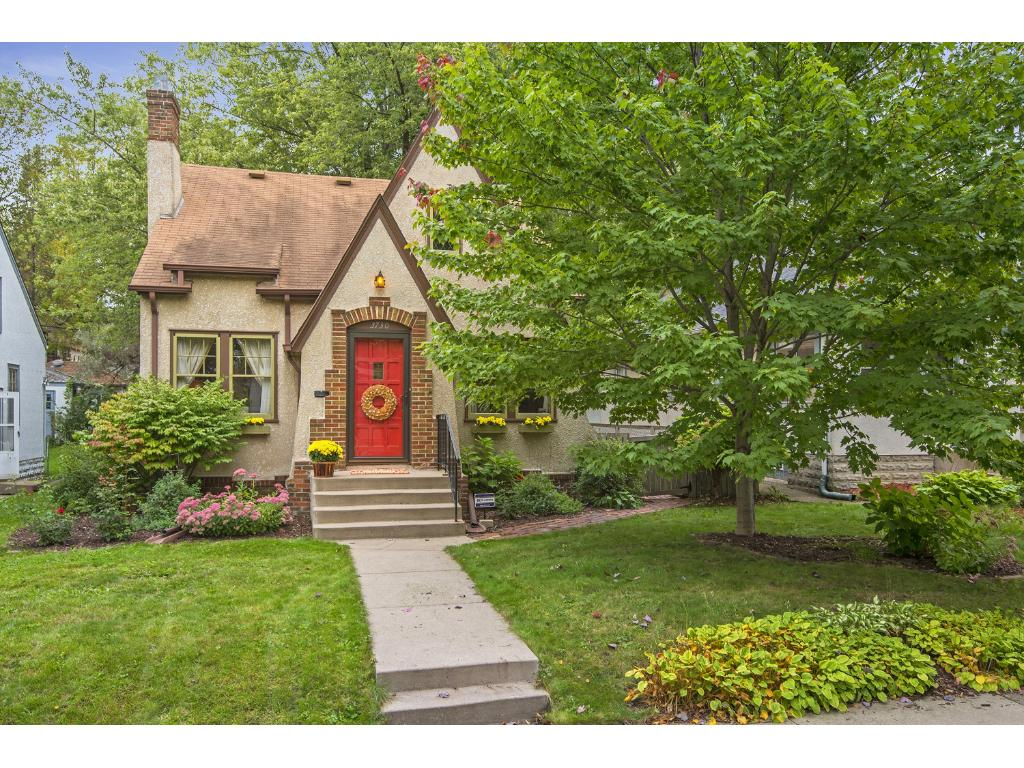 Walk to the Parkway!  Adorable story-book Tudor with many original details intact.