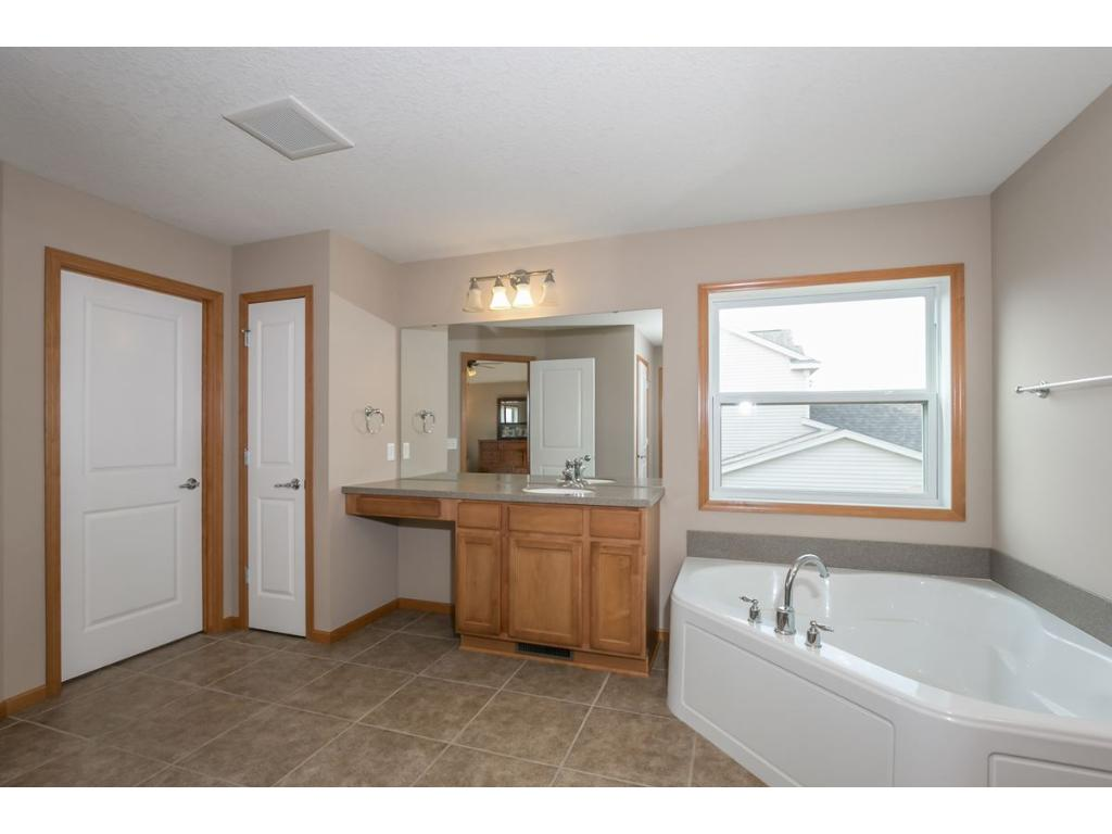 Large Master Bath with separate Tub/Shower, Water Closet & 2 Large Walk-In Closets.
