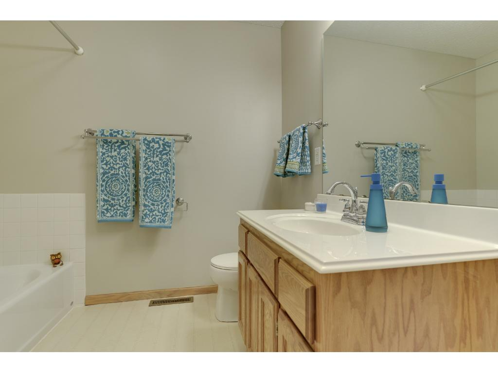 Master bath features separate tub and shower.