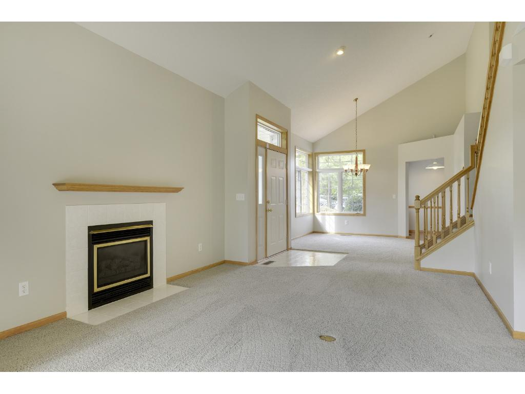 Living room with vaulted ceilings and gas fireplace.