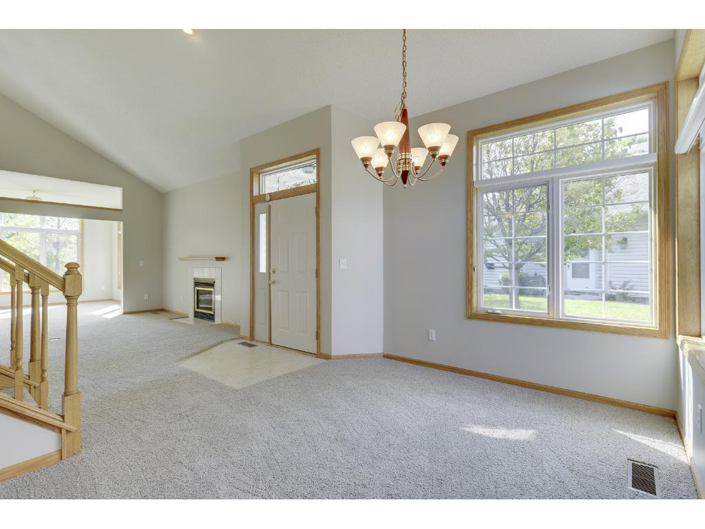 Open floor plan - view of entry, dining room, living room and porch.  New carpet and paint throughout.