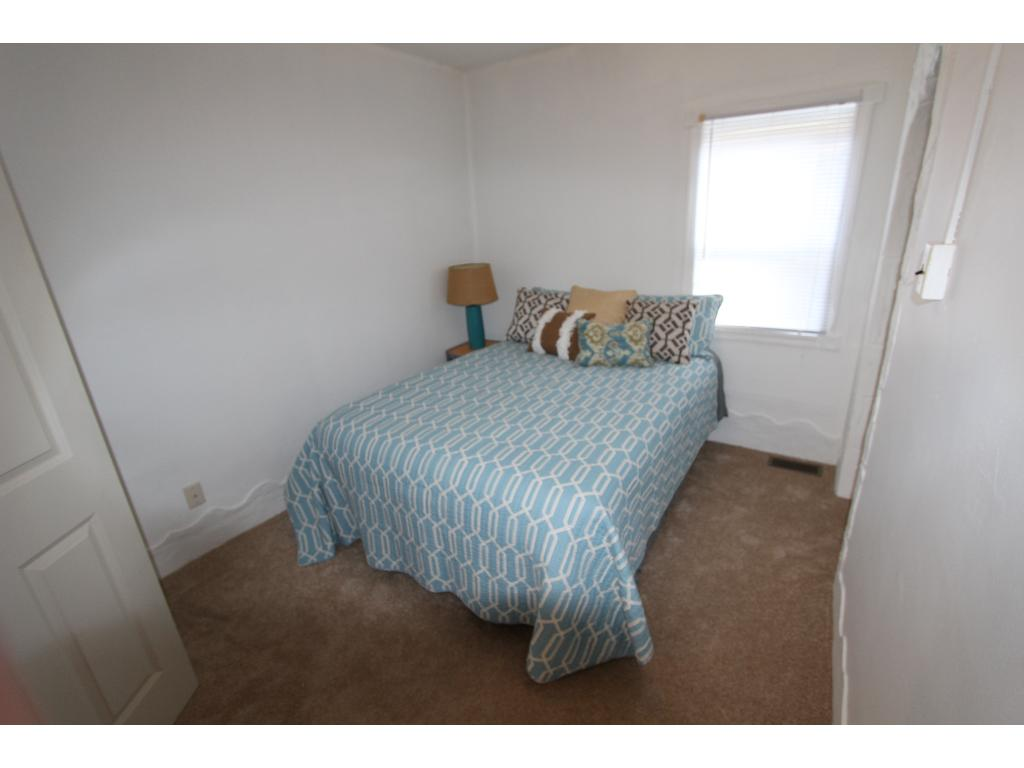 Second bedroom has fresh carpet and access to the upper level storage