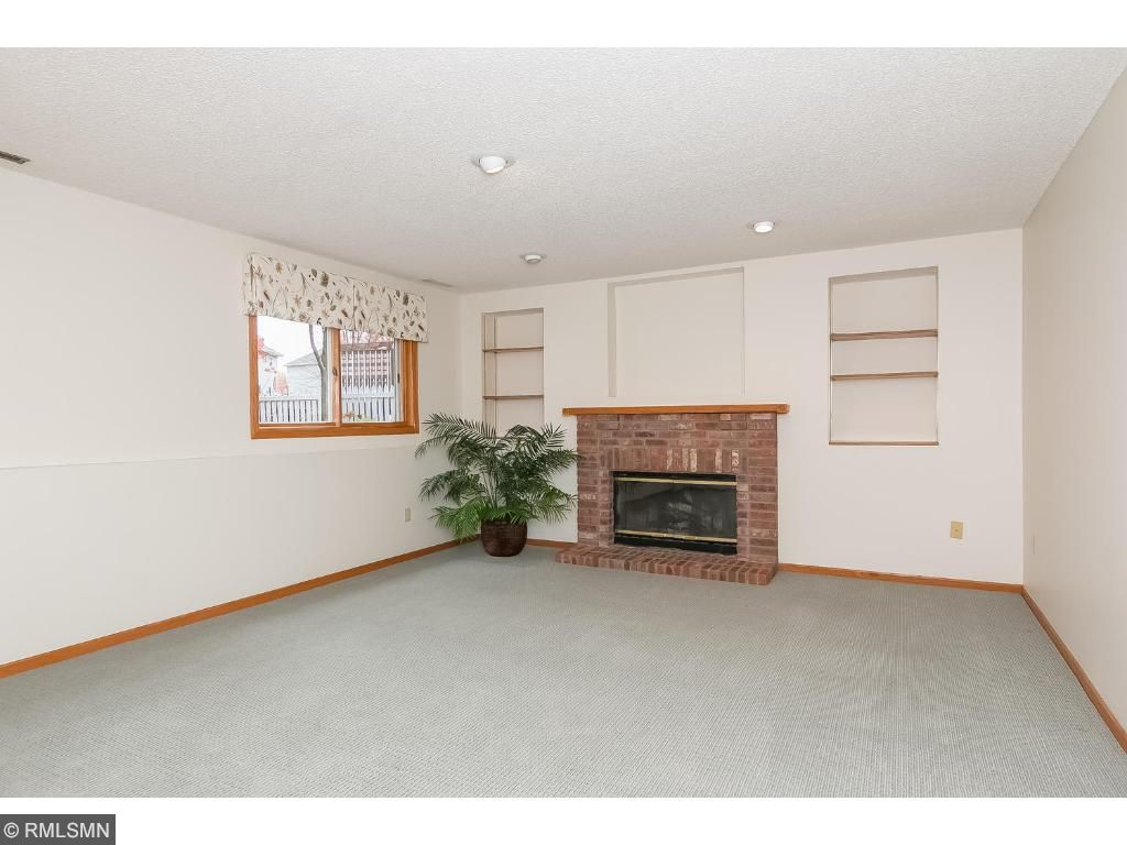 Family room in the third level with a brick fireplace