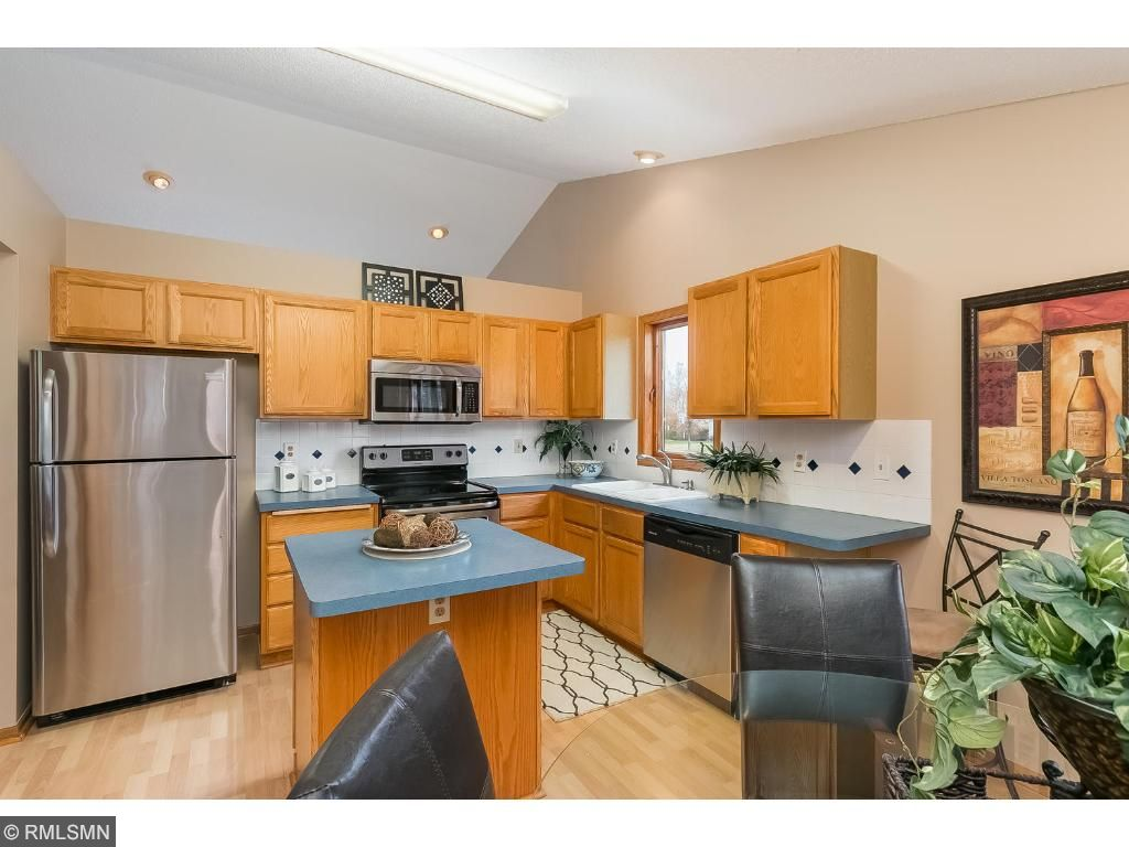 Vaulted kitchen with brand new stainless steel appliances