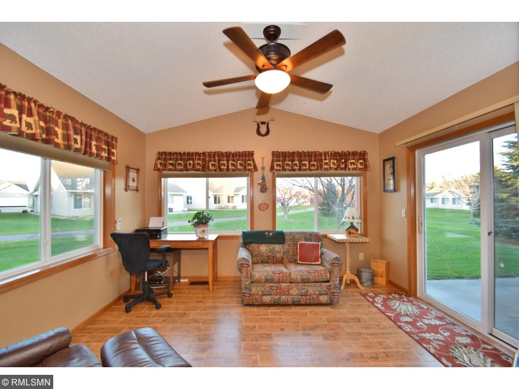 Sunroom has new ceramic flooring, heat source ceiling fan and in-floor heating