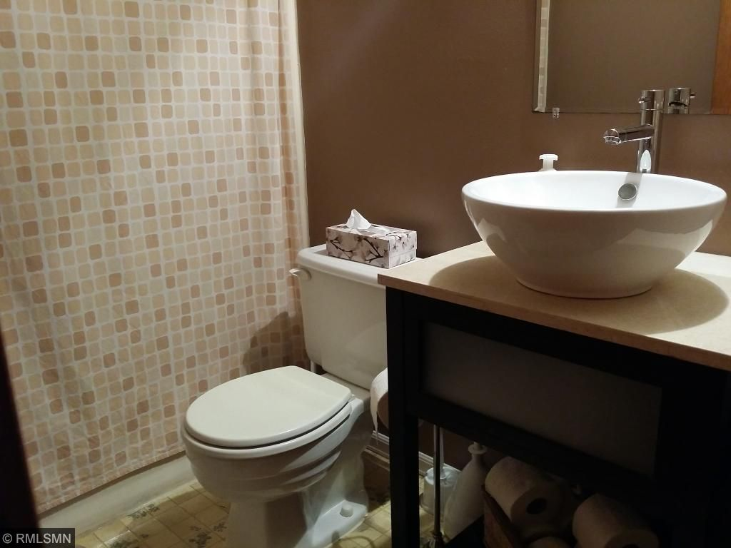 Updated upper level bath with vessel sink