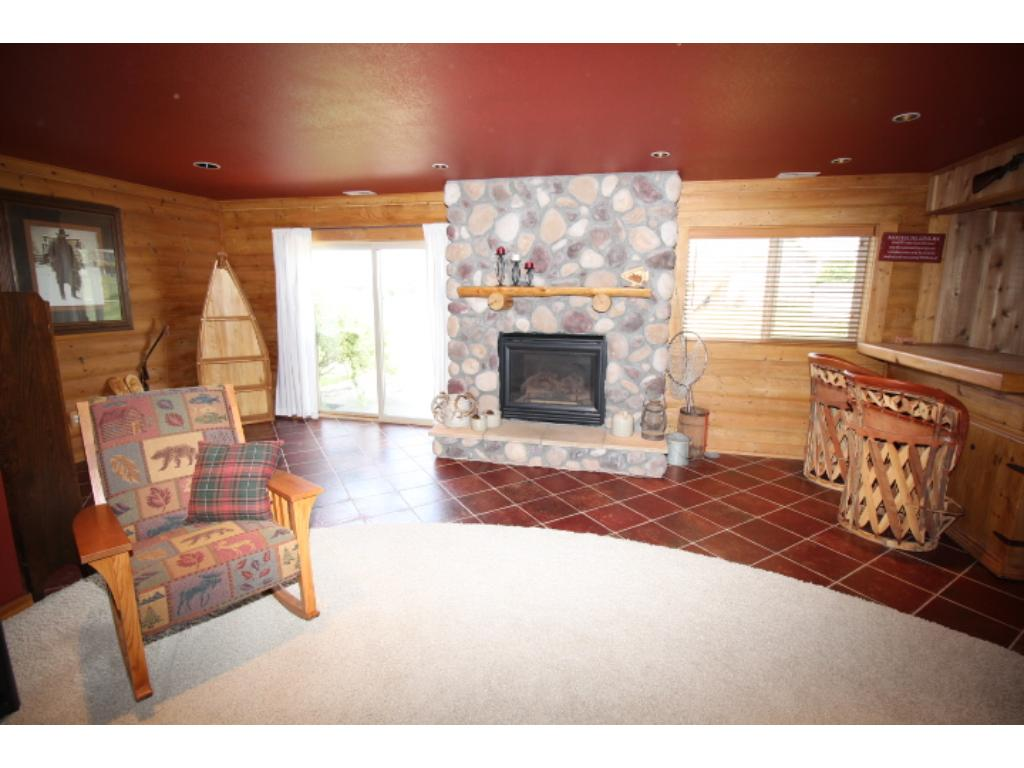 Snuggle up to the beautiful fireplace. Also walks out to patio area.