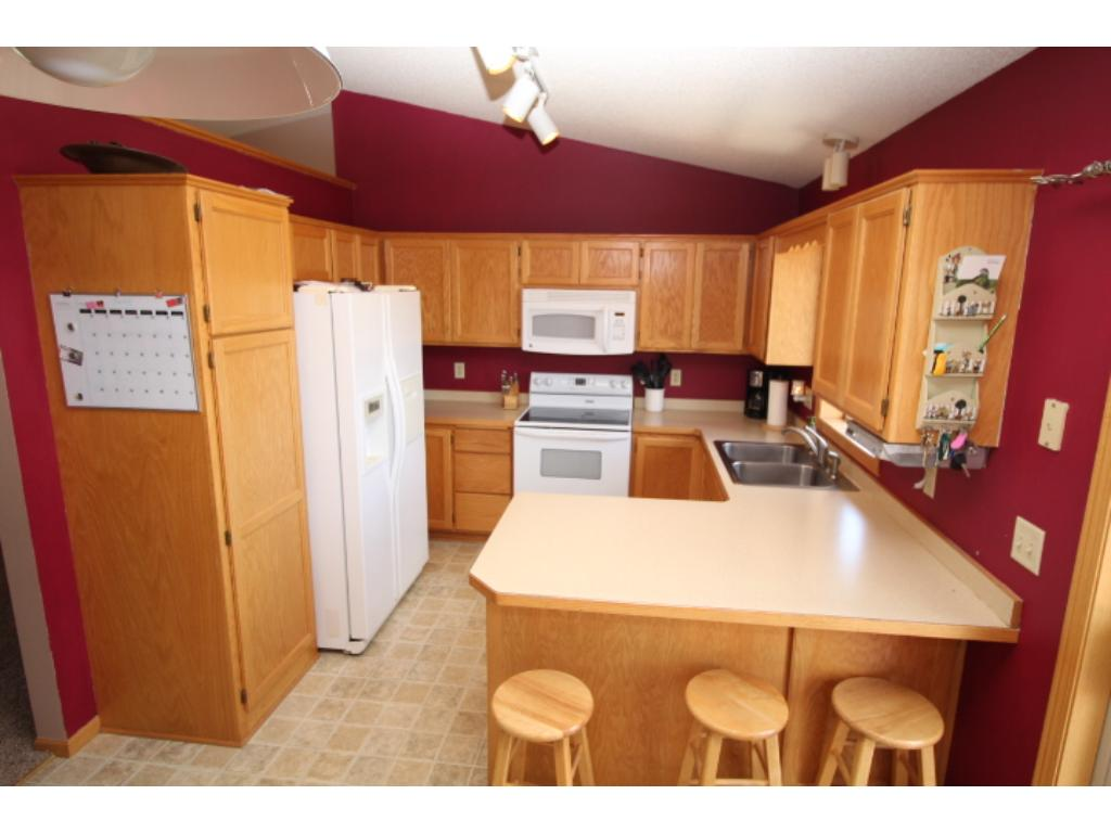Kitchen area with lots of cabinet and panty space.