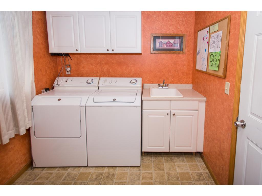 Main level laundry/mud room located off the garage and kitchen/dining area.
