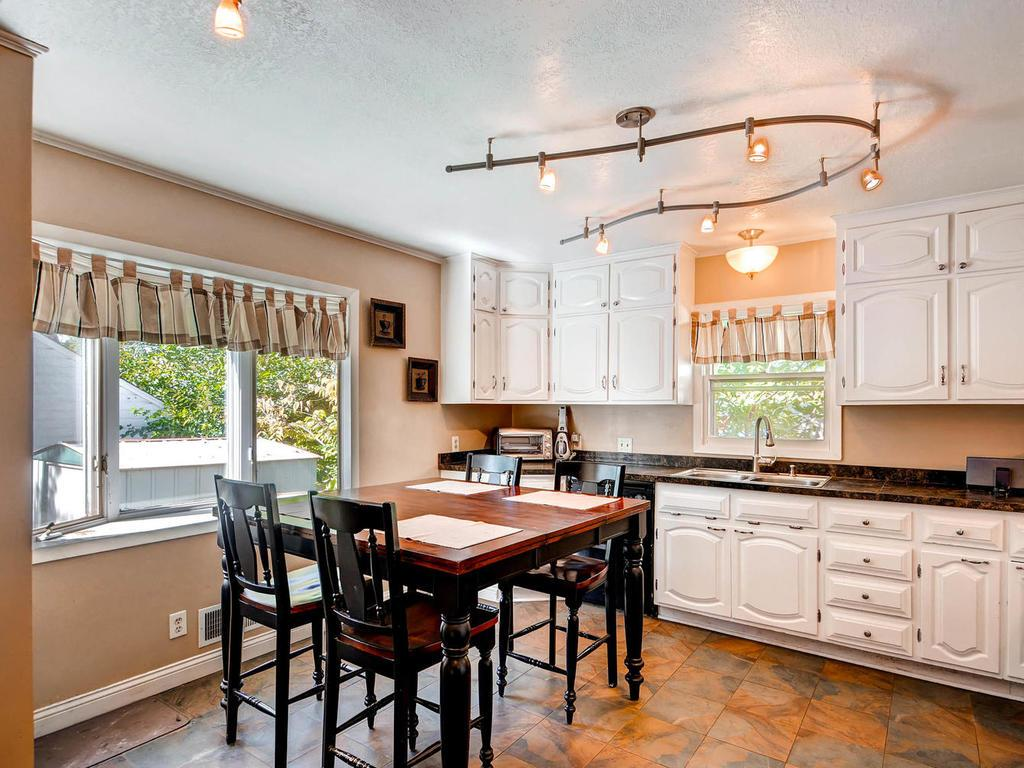 Renovated kitchen with tile floors and views of the fenced back yard.