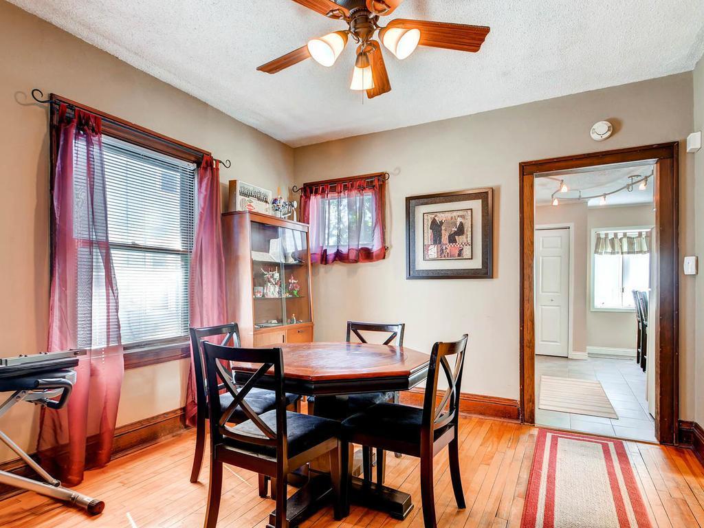 Dinning room with gleaming hardwood floors.