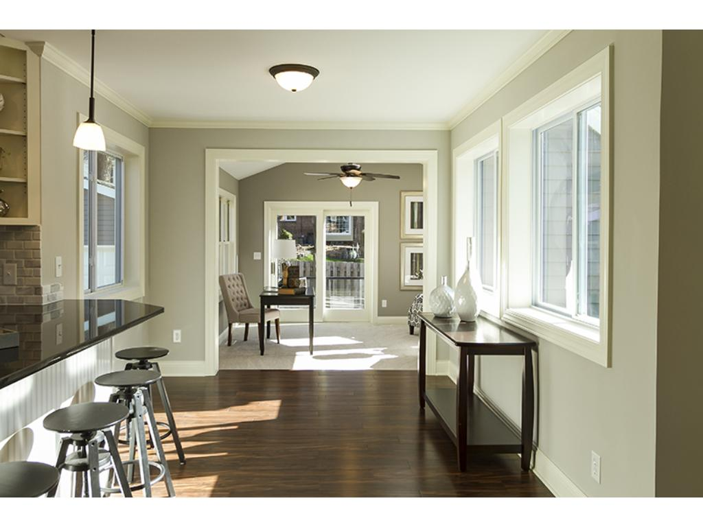 View through the informal dining area into family room.  Light filled spaces with open floor plan.