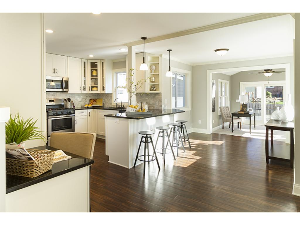 Gorgeous new kitchen with maple cabinets and granite counter tops.  All new eco friendly solid bamboo flooring is stunning.