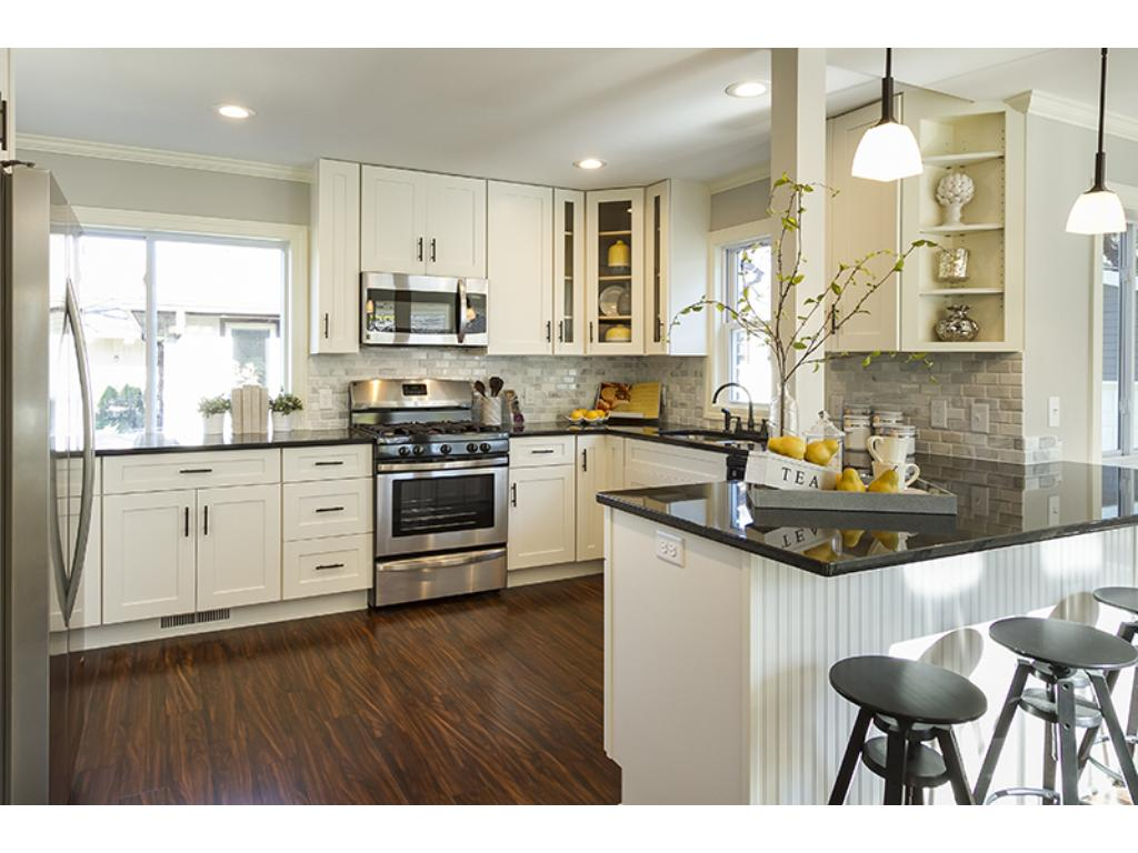 Beautiful kitchen with breakfast bar and tons of cabinet space.