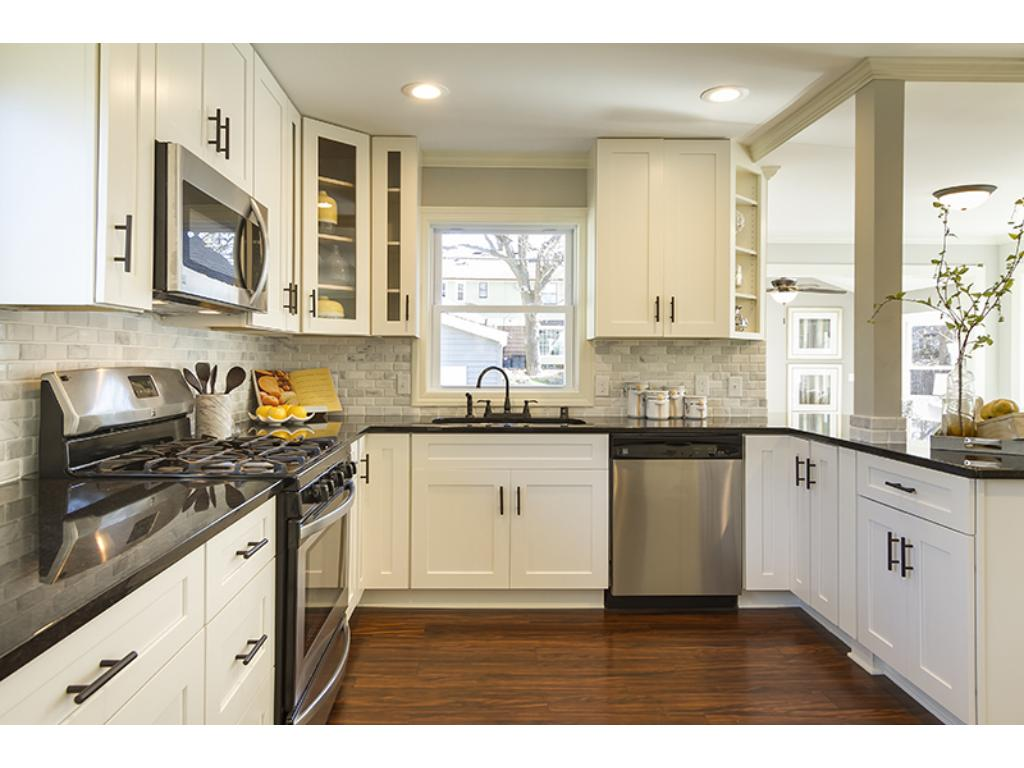 Gorgeous layout with kitchen opening to the dining room and family room.