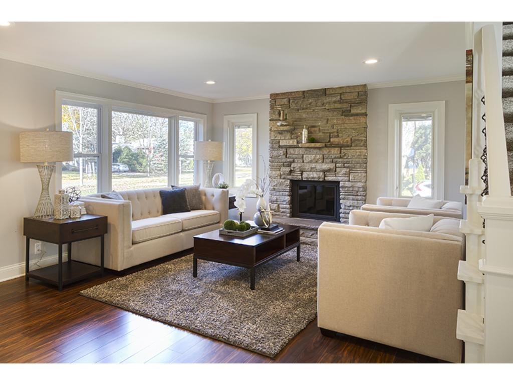 Living room with an elegant stone fireplace.