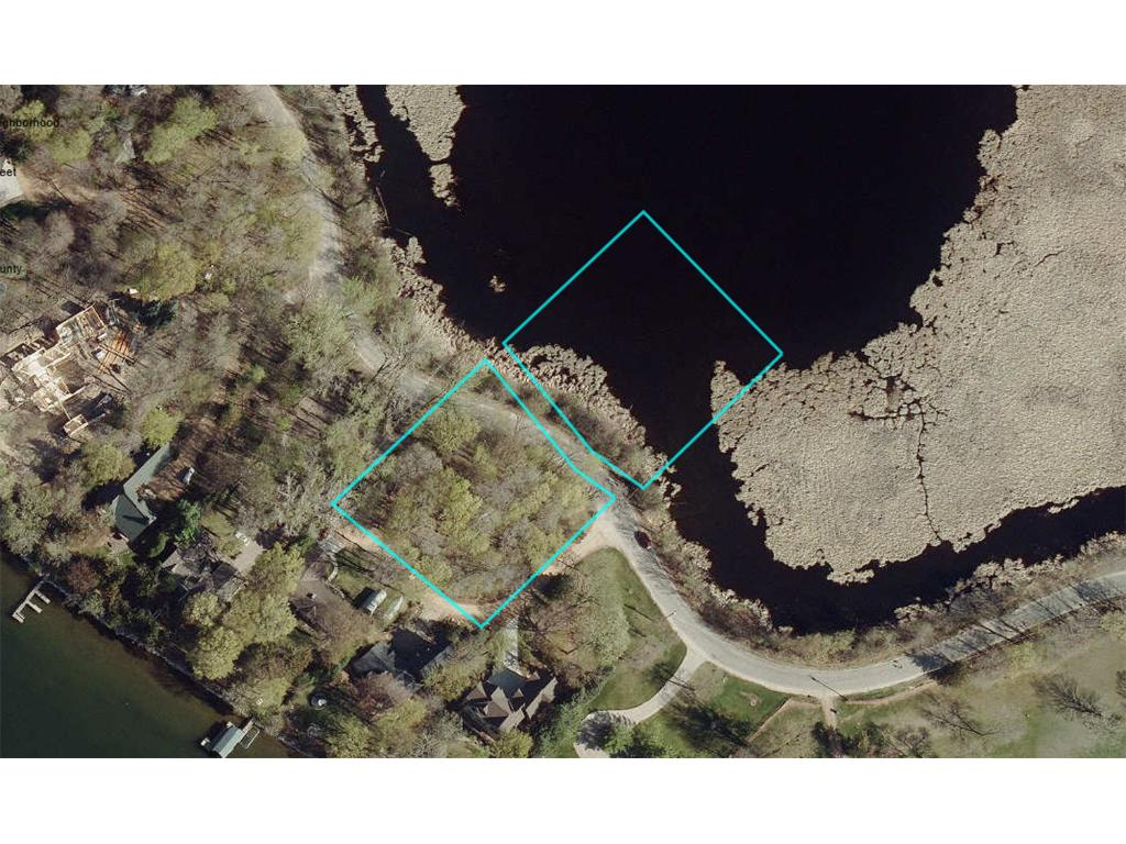 Wetlands, wooded privacy & plenty of room to roam on this huge 1.73 acre lot on Lake Minnetonka's, Enchanted Island.