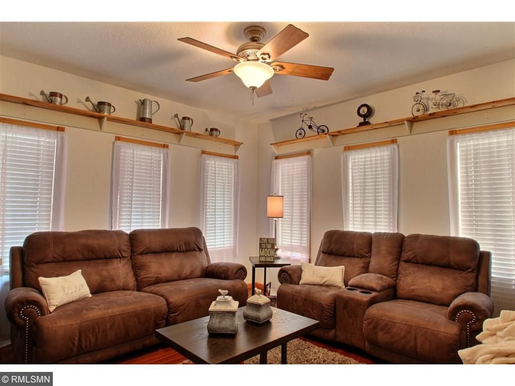 This sitting room is located off of the main entrance. There is a space for everyone in this home.